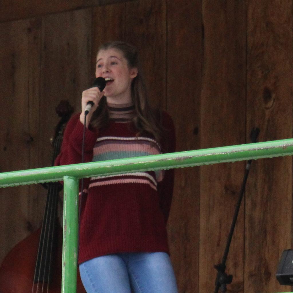 Hadley Mustakas sings at the Wellesley Idol 2019 Finals